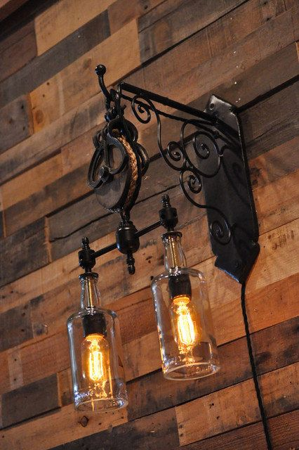 Nice custom double bottles pulley lamp made with hand-made wall bracket, rustic pulley and 2 clear or tinted glass bottles. It can be made with any two bottles of your choice, whether they be wine bottles or liquor bottles like Whiskey/Whisky/Scotch one (any brands, Scottish or Irish). Very similar to previous Whiskey Bottles Pulley Lamp except the pendant fixture replaced by a wall fixture. This one can be made by yourself (if you find parts) or you should simply buy one…