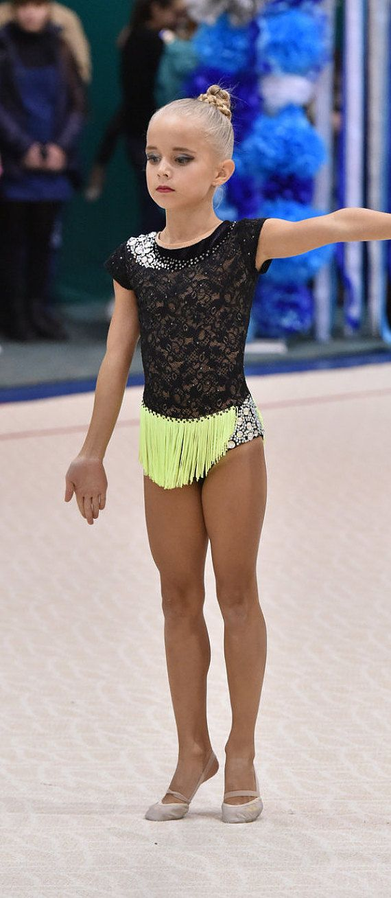 Beautiful designer rhythmic gymnastics leotard handmade. Shown as an example of work we do. The leotard for the rhythmic gymnastics competition made with over 2000 rhinestones very high quality and over 40 sew- on rhinestones very high quality. Handmade product thats why every item might have different color and shape.You can order any size, just let us know girl's measurement. Please let us known if you have any questions.