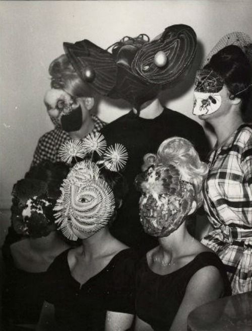 kirgiakos:  Denise Bellon-Gathering of Surrealists group with mask wearing guests (france | ca.1950s-1960s)
