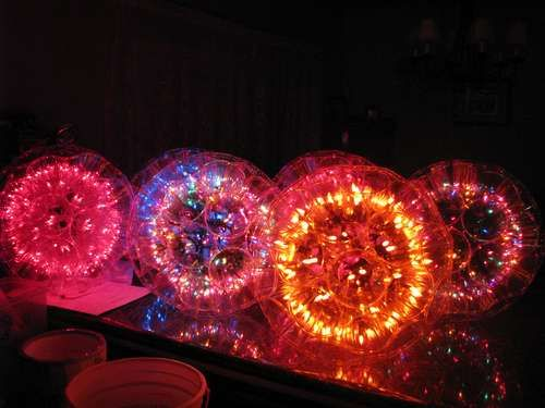 """DIY lamp called a """"Sparkle Ball"""" made of plastic cups, LED lights and zip ties. From site called Instructables."""