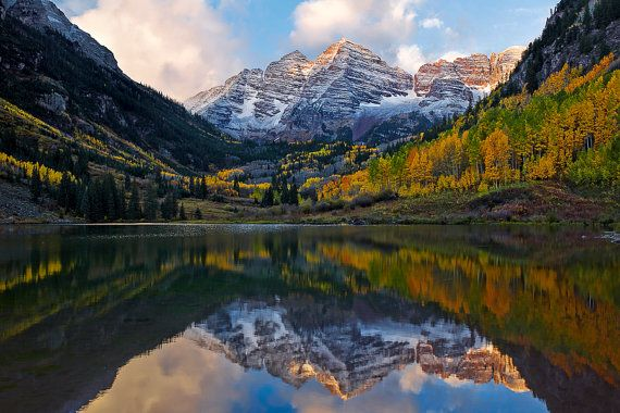 A snow storm powdered the Maroon Bells over the late evening of September 28.  I had planned to sleep late in Aspen after a weekend Denver wedding.  But as I was awakened to wet streets, I checked the weather maps and I decided to make the ride out to the lake.  Arriving, I could see in the moonless night that the bells were brighter than surrounding horizon suggesting snow cover. What a beautiful morning! Prints @ BuiterPhotography.etsy.com