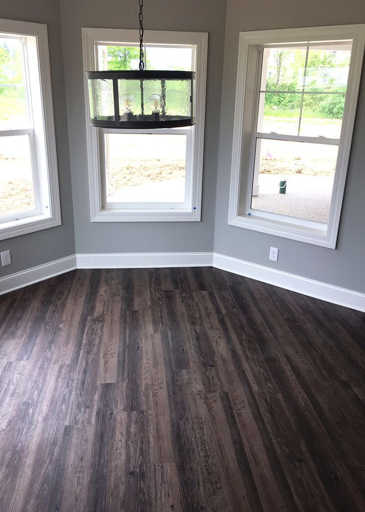 Distressed Luxury Vinyl Plank Flooring in walkout basement  |  LVP  |  Modern Rustic  |  New Home Construction  |  Home Bar & Entertainment Ideas