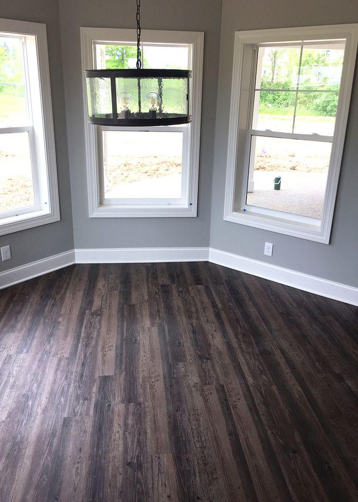Distressed Luxury Vinyl Plank Flooring in walkout basement  |  LVP  |  Modern Rustic  |  New Home Construction  |  Home Bar & Entertainment Ideas