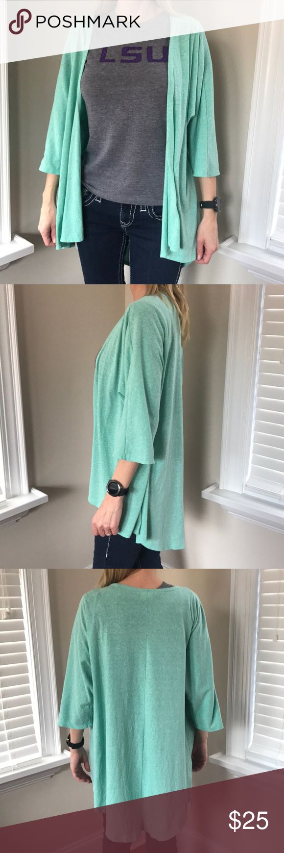 LuLaRoe oversized mint cardigan LuLaRoe cardigan  Oversized Mint blue color Lower in the back (low to mid thigh) No flaws Size small  Bundle and save! Prices are always negotiable 💜💙 LuLaRoe Sweaters Cardigans