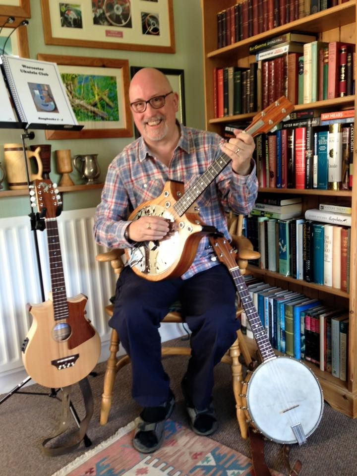 Steve Vernals in the UK with the first commissioned Resobarinator - Barebones Folk Instruments Baritone resonator ukulele. Note the other two Barebones models he also has.
