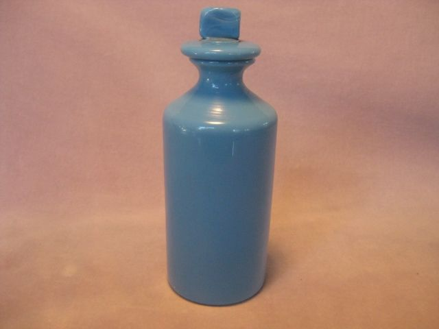 A rare pale blue glass  pharmacy bottle  and stopper.  Rough pontil mark to the base. English     1880  Height 8 1/4""