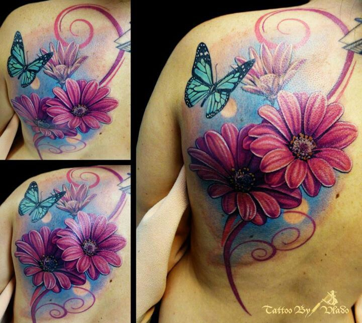Blue butterfly and pink flower tattoo.Could be my thigh piece.