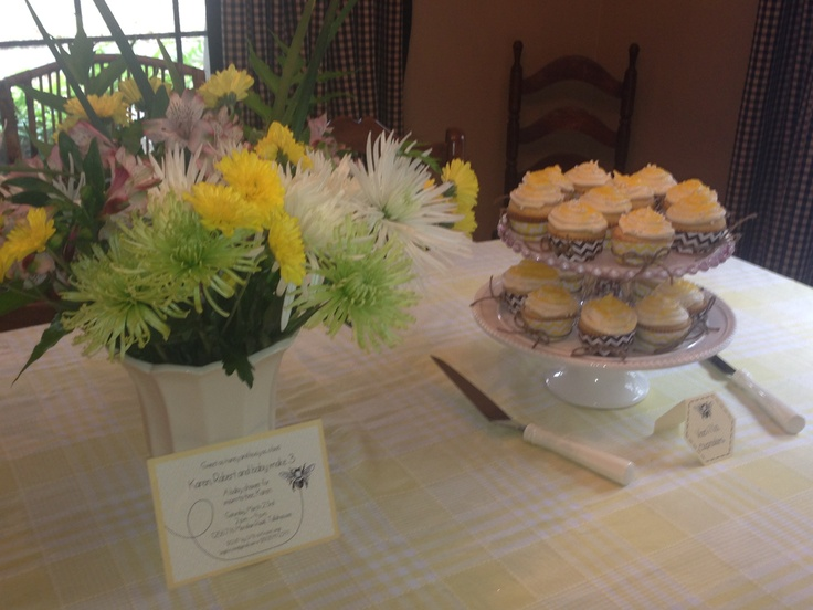 Vanilla cupcakes and fresh flowers for baby bee shower.