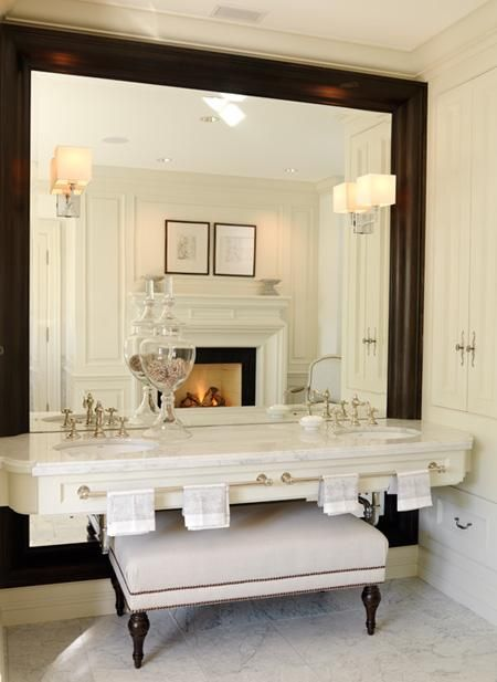Full wall mirror in your bathroom.