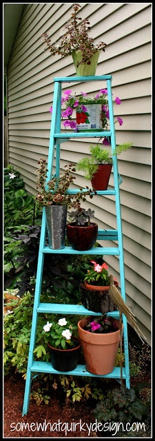 ladder yard art - so colorful and charming.  Find an old ladder and use it to display potted plants