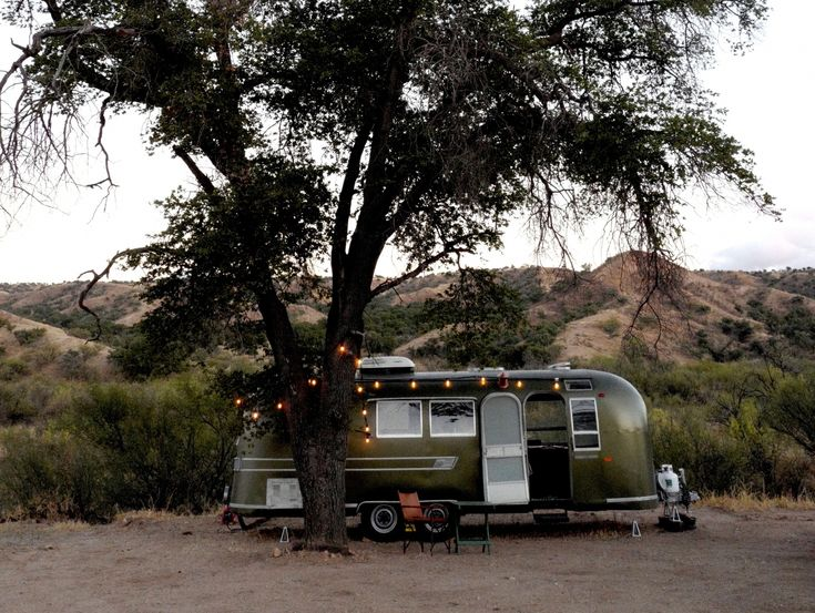 An olive paint job and Victorian card table for a 1968 Airstream Overlander? That was the approach taken by San Miguel-based Mex-chic design house Casamidy.