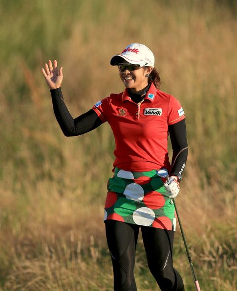 Pornanong Phatlum Photos - Pornanong Phatlum of Thailand celebrates holing a chip shot at the par 5, 18th hole for an eagle during the first round of the 2014 Ricoh Women's British Open at Royal Birkdale on July 10, 2014 in Southport, England. - Ricoh Women's British Open: Day 1
