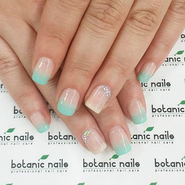 Cute baby blue French tips. Have that fresh and sweet look on your nails by adding baby blue French tips with your white French tips together. You can also add embellishments on top of the nails such as silver and colored beads.