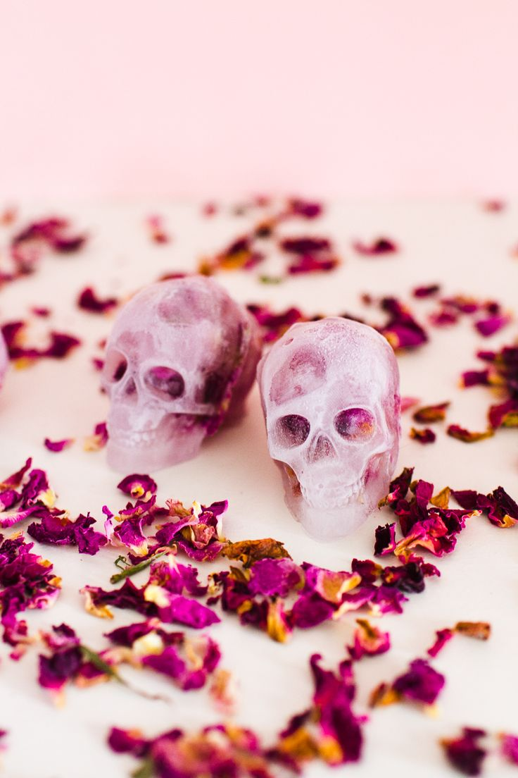 Halloween doesn't have to be gross and spooky all of the time, why not make a batch of these pretty skull ice cubes?! They're filled with edible rose petals too!