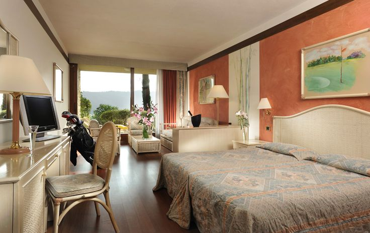 Junior Suite - Spacious rooms of around 40 square metres, all enjoy a splendid view over Lake Garda. The rattan furnishings and pastel-coloured fabrics are in perfect harmony with the vivid tonalities of the walls. All suites feature bathrooms in precious marble with bathtub and shower, hair dryer, telephone, satellite television, safe, minibar, air conditioning and furnished balcony or terrace.