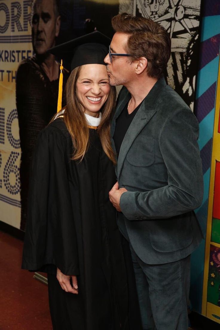Robert Downey Jr. congratulates his wife Susan Downey after she received the Mary Pickford Outstanding Alumni Award from the USC film school, May 14, 2016