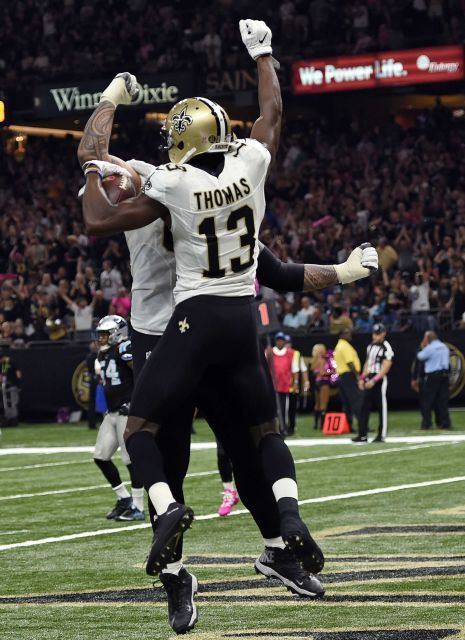 Panthers vs. Saints:      October 16, 2016  -  41-38, Saints  -    New Orleans Saints wide receiver Michael Thomas (13) celebrates his touchdown in the first half of an NFL football game against the Carolina Panthers in New Orleans, Sunday, Oct. 16, 2016.