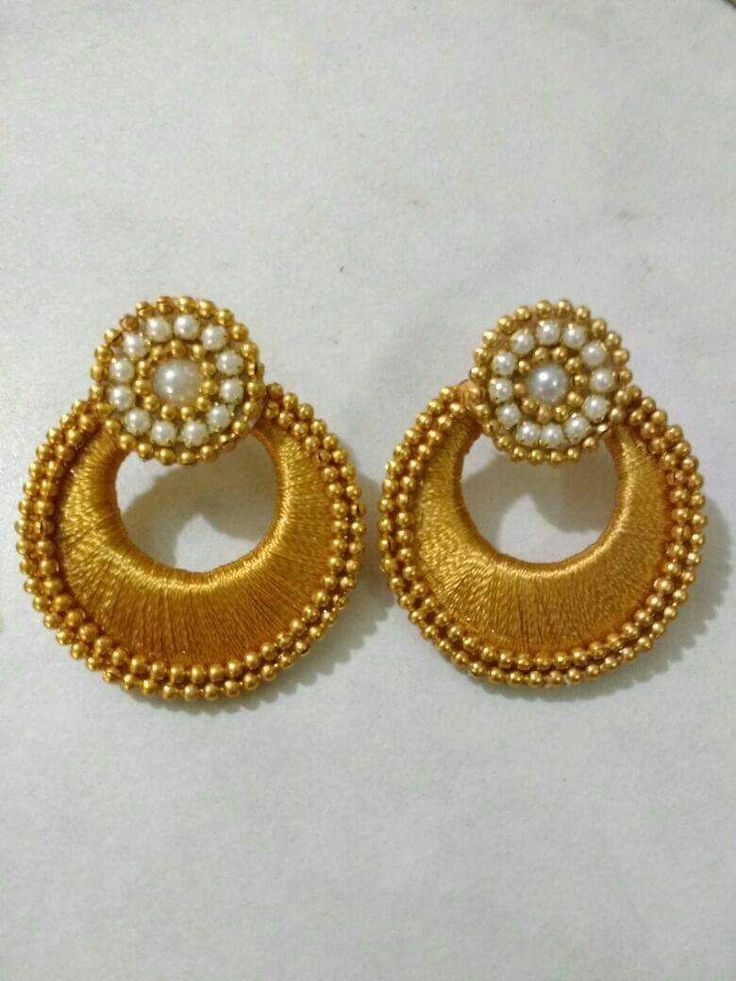 Handmade Simple and Well-designed golden Silk thread, white beads and artificial pearl Earring. Pair with ethnic Indian wear like sarees, salwar suits and lehengas.