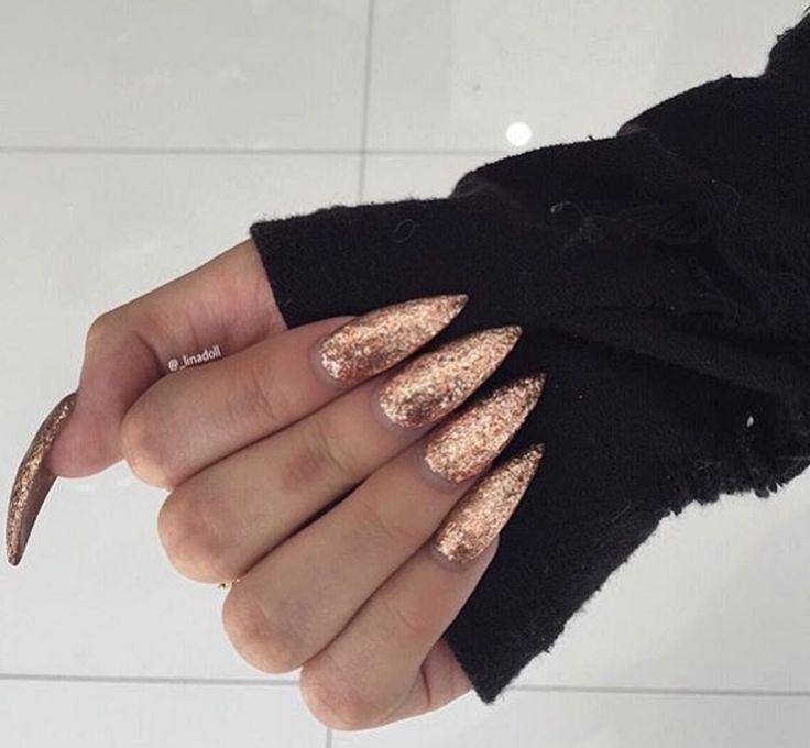Gold stiletto nails                                                                                                                                                                                 More