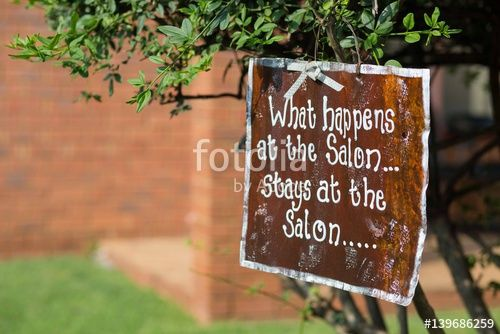 A Salon Sign Post