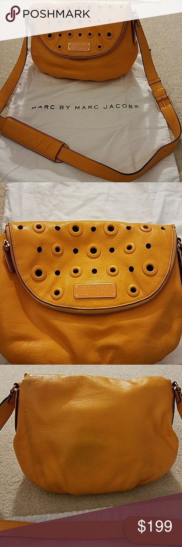 Authentic Marc Jacobs Crossbody Beautiful sundance orange purse with adjustable strap. Perfect for spring and summer. I always get tons of compliments on this bag. Magnetic button closure. Also has a zipper along the edge flap which houses an additional pocket. Comes with original duster bag.   Great condition. The back of the purse does have a dark shaded area from new jeans that rubbed against it. See picture. Marc by Marc Jacobs Bags Crossbody Bags