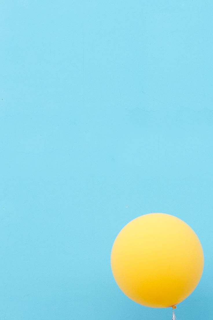 Blue sky yellow balloon