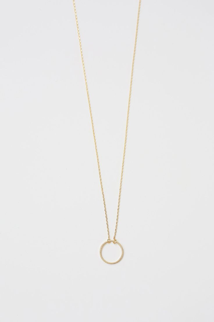 A delicate and dainty necklace with a circle pendant at the bottom. All jewelry is final sale.