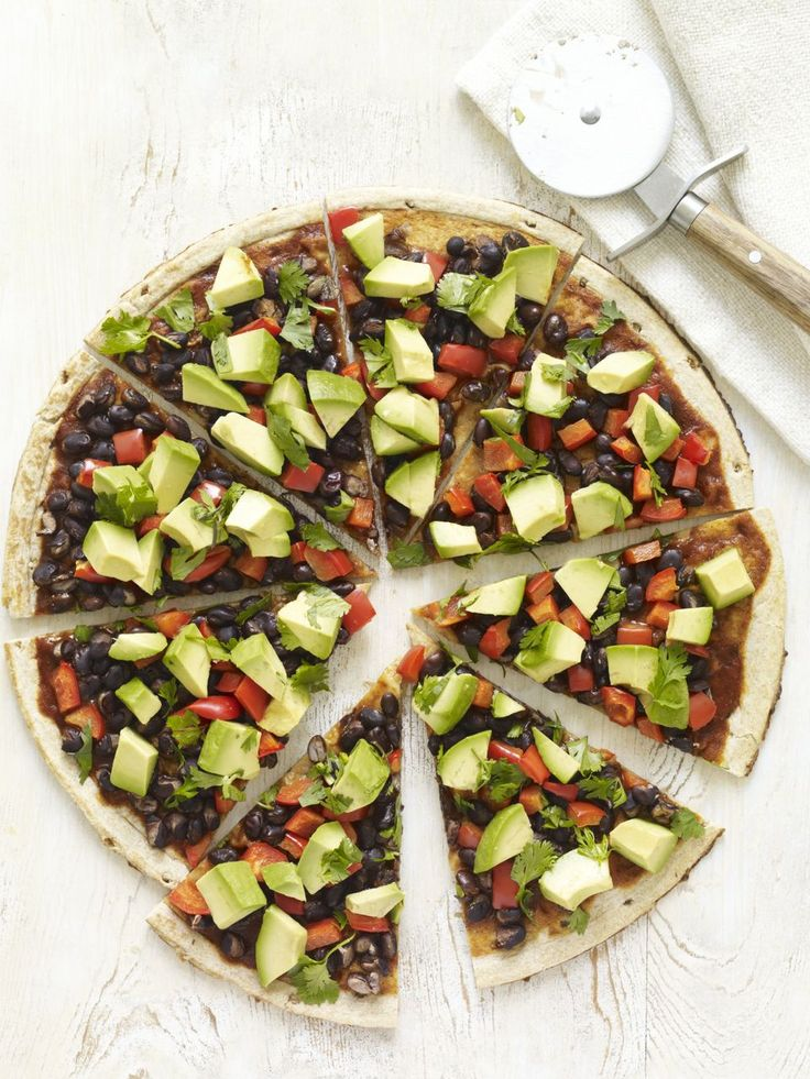 South-of-the-Border Pizza  Makes 1 12-inch Pizza Ready In: 20 minutes  INGREDIENTS:  1 (12-inch) precooked whole- grain pizza crust 1 cup Enchilada Sauce 1 cup cooked or canned black beans, rinsed and drained 1 red bell pepper, seeded and finely diced 1 large avocado, pitted, peeled, and diced ½ cup chopped fresh cilantro