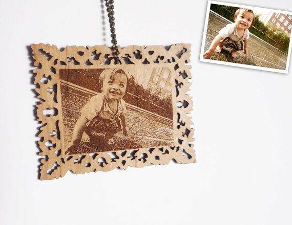 Hey, I found this really awesome Etsy listing at http://www.etsy.com/listing/62336511/photo-ornament-custom-laser-engraving