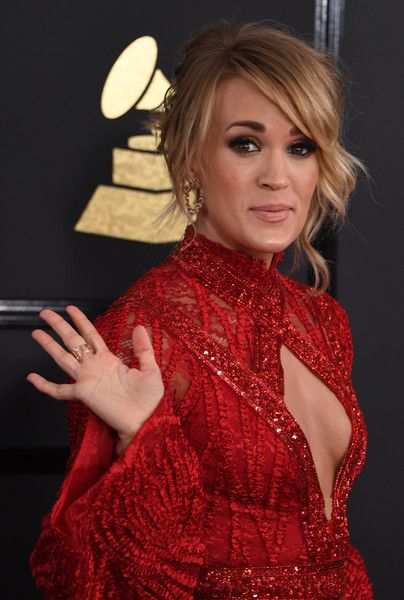 Carrie Underwood -  She wore a dramatic, long-sleeved Elie Madi gown with gold hoop Nigaam earrings, EFFY jewels and Jimmy Choo 'Max' sandals. | The 59th GRAMMY Awards at STAPLES Center on February 12, 2017 in Los Angeles, California. - The 59th GRAMMY Awards - Arrivals
