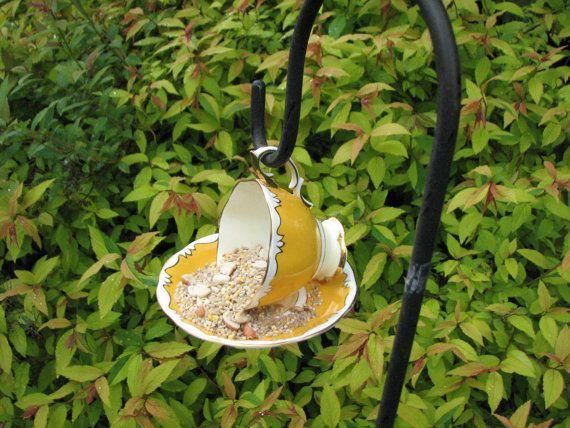 http://www.grainsofearth.org/17-unique-bird-feeders/#  Vintage Teacup Bird Feeder