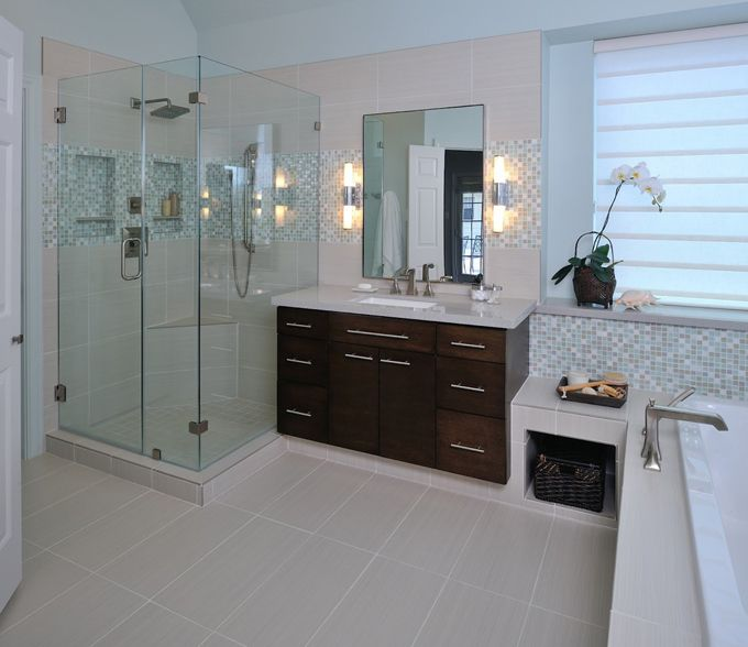 I love a little mental vacation! This soothing spa-like bathroom designed by Carla Aston, an interior designer out of The Woodlands, Texas is just the ticket! The homeowners wanted something modern that you'd expect to see in a boutique hotel suite, but at the same time uplifting and fresh. The paint on the walls (Sherwin-Williams Sea Salt) and the shimmery mosaic tile are so pretty here, but I love all of the simple, clean lines too.