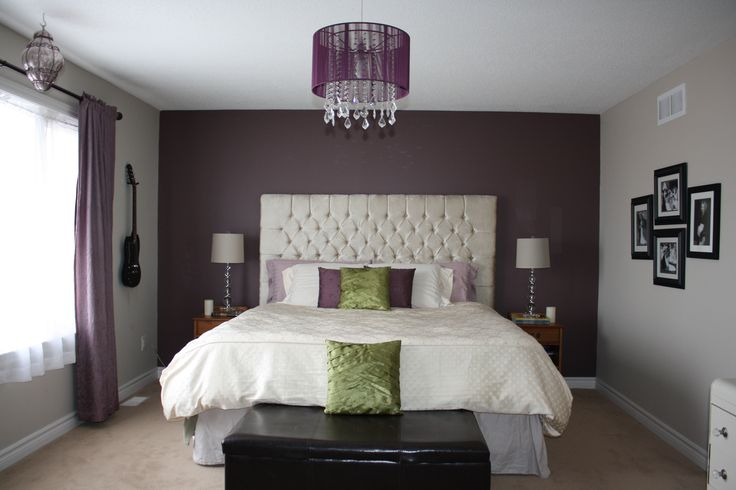 My Master bedroom makeover.  I made this King sized diamond tufted headboard in my upholstery class, based one I saw from Union Lighting in Toronto.  Feature wall is painted Amazon Soil (deep purple) from Candace Olson's -Benjamin Moore colour choices.  Purple crystal chandelier - Bouclair.  Crystal lamps from Homesense.  Vanity - reclaimed from ReStore- painted cream and added new crystal drawer pulls.  Still need a couple of mirrored bedside tables to complete the look I want.