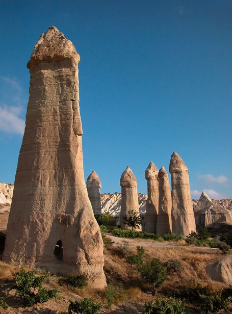 Fairy chimneys (rock formations) in Cappadocia, Turkey >>> This area is called Love Valley for obvious reasons... :)