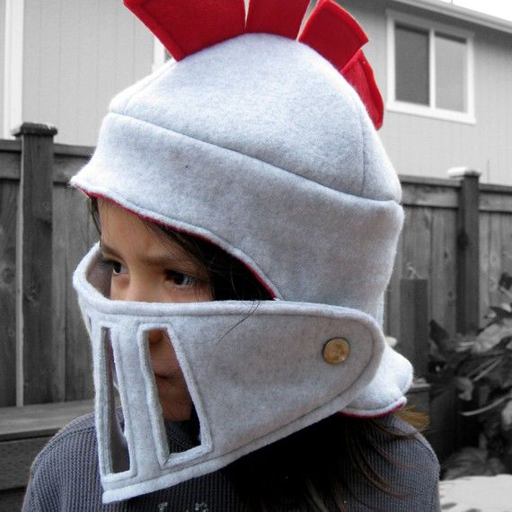 """Cool knight's helmet/hat with red plume and face shield.  From """"worldofwhimm"""" on etsy."""
