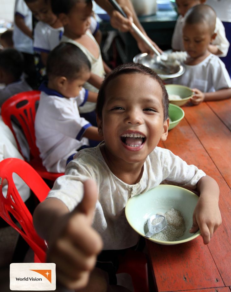 """I love this #dessert. I don't often eat it at home,"" says 5-year-old Kyaw Lin from #Myanmar. He's eating a dessert made of #coconutmilk and #rice, served at his #school so that children can concentrate in class and have a good meal. Photo by Khaing Min Htoo, #WorldVision"