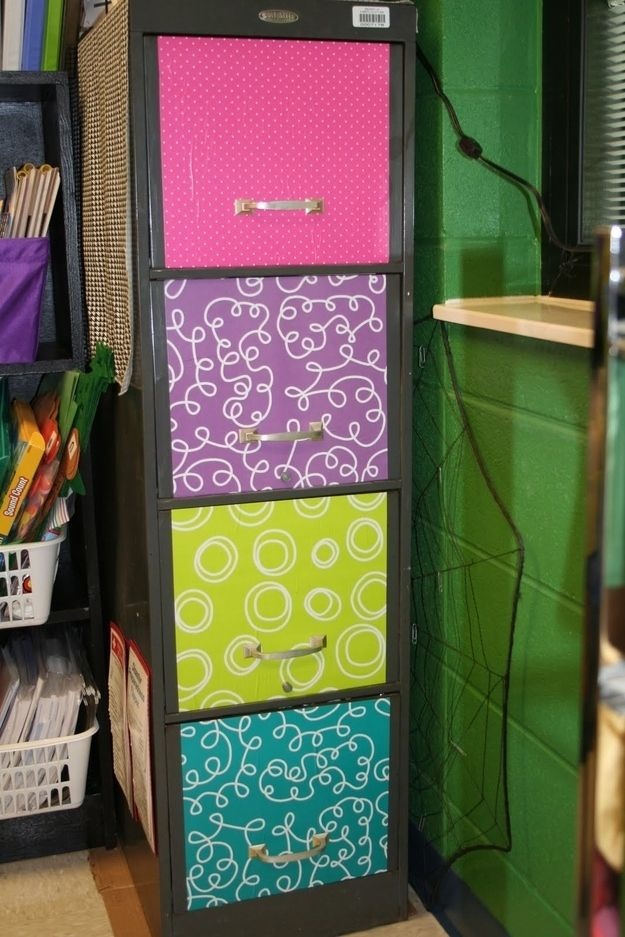 Mod podge wrapping paper to the front of your filing cabinets.   36 Clever DIY Ways To Decorate Your Classroom