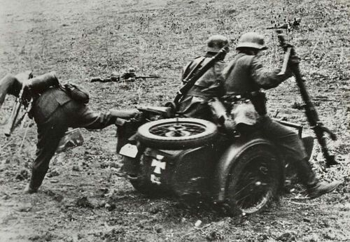 The riders on this Zundap K750 react after coming under fire.