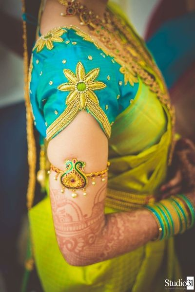 South Indian Jewelry - Gold Armlet with a Detailed Cut Blouse | WedMeGood #wedmegood #indianwedding #indianbride #southindianwedding #southindianbride #armlet #gold #southindianblouse