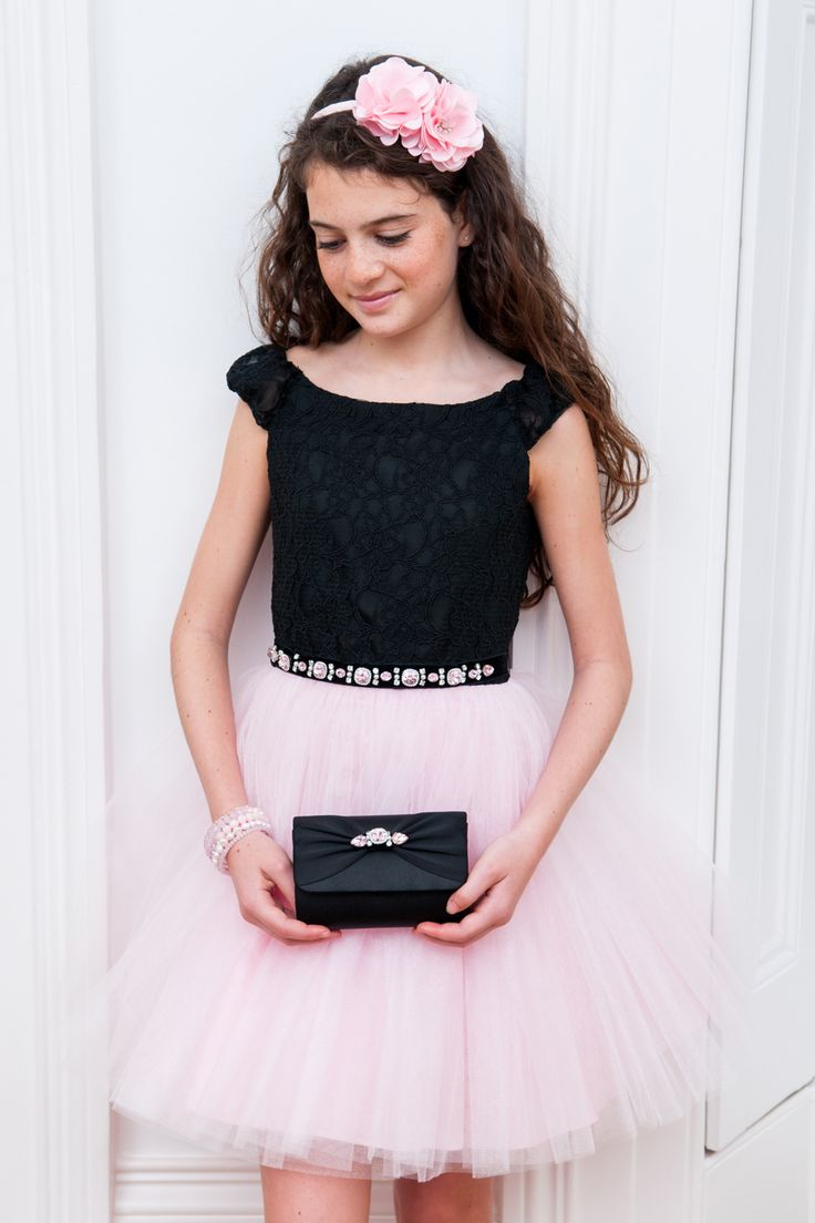 Your girl will be photo-ready in no time with this black and pink pretty prom dress. A winning outfit choice for prom and party dates, this feminine above-the-knee length dress is sublime in every way. Featuring a form-fitting black lace bodice that contrasts with a soft pink full tutu skirt, now your young fashionista can go to the ball looking luxurious. Elasticated puffed sleeves can be worn on or off the shoulders, and the neckline of this dress is scooped. Note the smooth black velvet…
