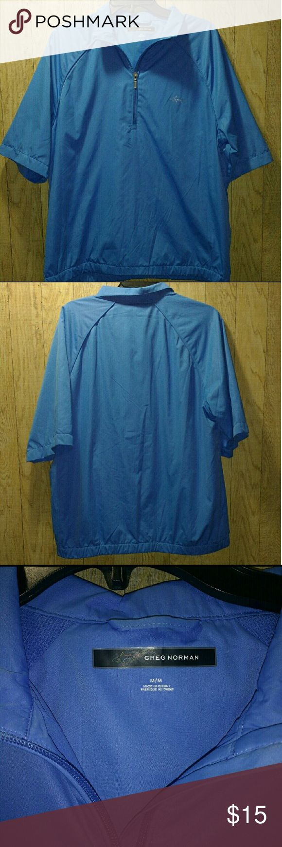 Weather Essentials Pullover Jacket Greg Norman Weather Essentials Pullover Jacket  This quarter-zip jacket adds water resistance and wind protection in a great-looking lightweight layer. Features the iconic Greg Norman shark logo on the chest.  Size Medium  Weather Essentials Short Sleeve Quarter Zip Pullover Jacket Jackets & Coats