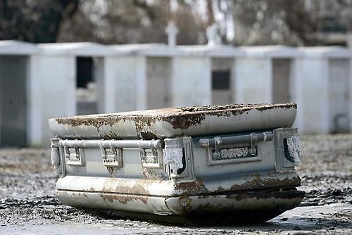 Casket Unearthed by Katrina's flood waters it sad the things that can happen after we are gone.