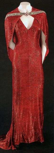 """1937 red evening gown designed by Gilbert Adrian and worn by Joan Crawford in """"The Bride Wore Red."""""""