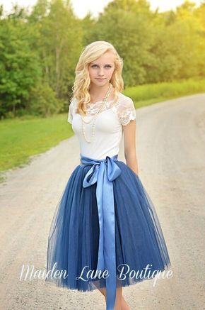 Beautiful tulle skirt made with a navy blue tulle in women's sizes including plus sizes. Skirt is made of 6 layers of the highest quality tulle and is fully lined with satin and has an elastic waist.