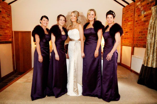 Bride with bridesmaids wearing purple dresses for a winter wedding at Rivervale Barn | www.allabouttheimage.co.uk