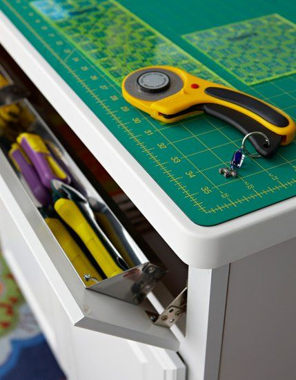 Drop Down Cabinet Drawers At A Work Station Corral Rotary Cutters.