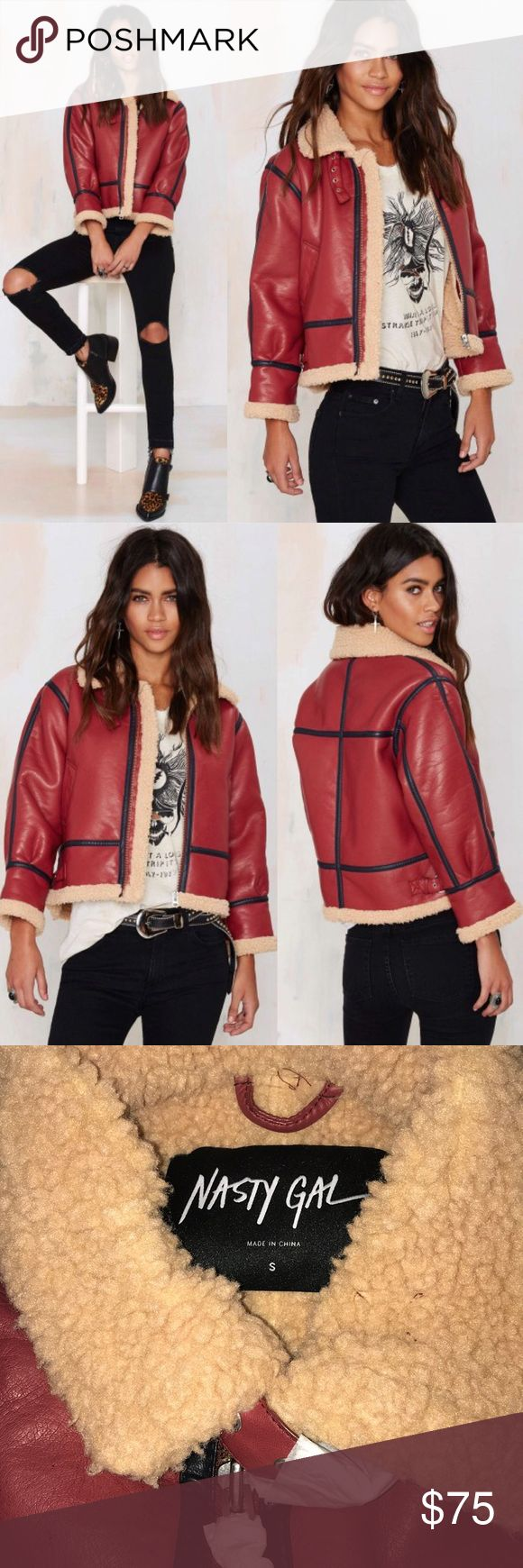 Nasty Gal Shear Force Vegan Leather Jacket Force to be reckoned with? Hell yeah. The Shear Force Jacket is made in a burgundy vegan leather and features shearling lining, black trim, welt pockets, and adjustable buckle closures at neck and sides. Front zip closure. Team it up with kicking ass and looking good doin' it. By Nasty Gal. Sold out at Nasty Gal. Brand new boutique item   *Polyester  *Runs true to size  *Model is wearing size small  *Dry clean only  *Imported Nasty Gal Jackets…
