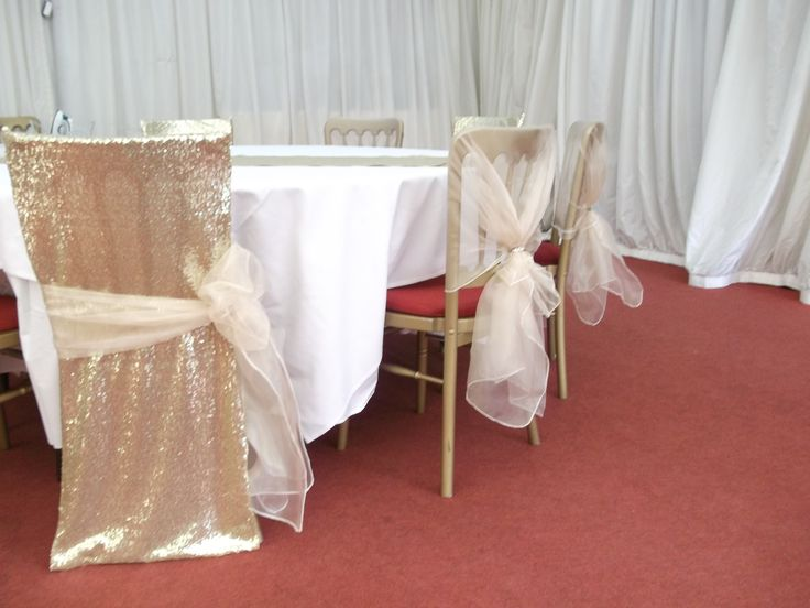 Gold Sequined chair veils and ivory organza sashes from Simply Bows and Chair Covers