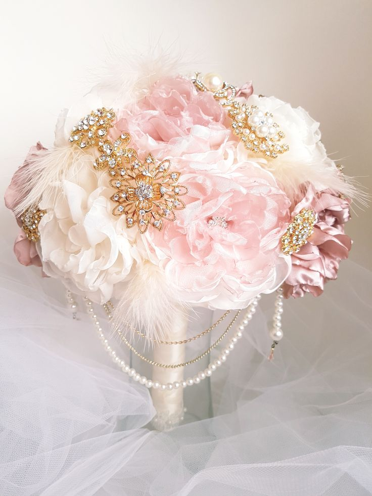"""Dusty Rose Pink Bridal Brooch Bouquet, Bridal Accessories, Wedding Bouquet.  Dusty rose and cream organza and satin handmade fabric flowers.  Gold tone brooches with wispy white feather accents, cascading chains and pearls. 11"""" bouquet."""