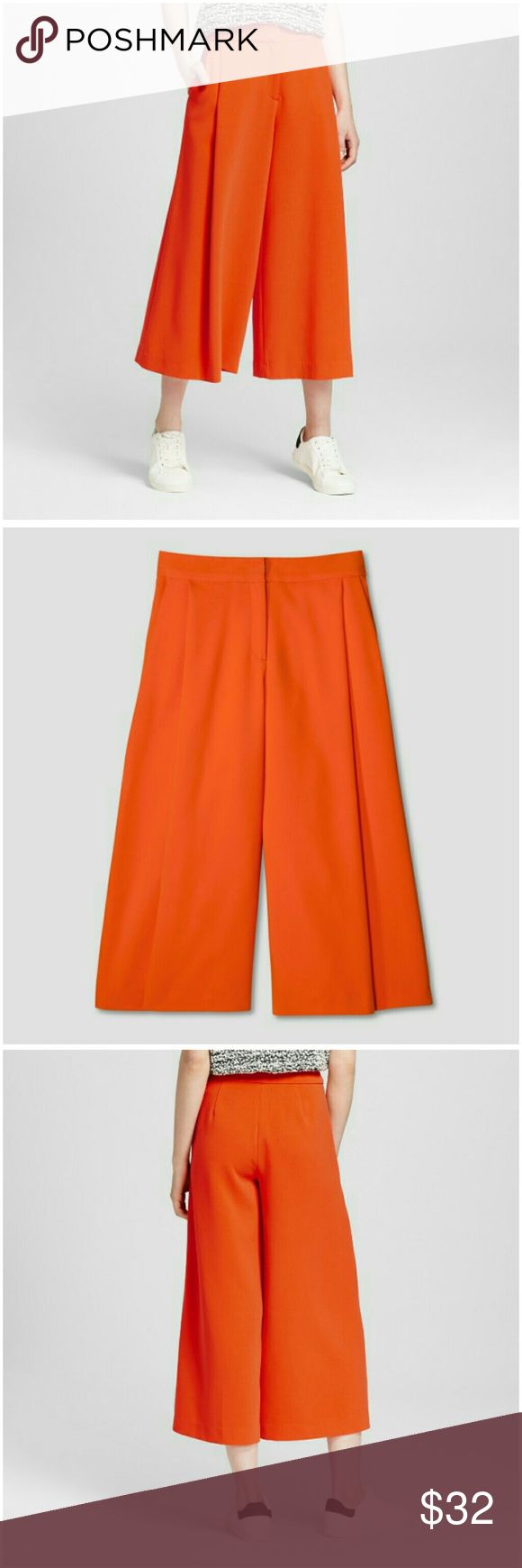 """NEW Victoria Beckham Orange Pleated Culotte SZ 10 Victoria Beckham for Target Orange Pleated Culotte Women's Size 10  Take a Risk -- Trade in your Midi for Culottes! So Chic & Sophisticated!  DETAILS: Wide Leg Trouser w/Pockets.  MATERIAL: 63% Polyester, 33% Rayon, 4% Spandex  - Super Soft!  SIZE: 10 Waist: 30.5"""" Hip: 40"""" Classic/Mid Rise  Smoke Free Home!  Bundle & Save! Victoria Beckham Pants Ankle & Cropped"""